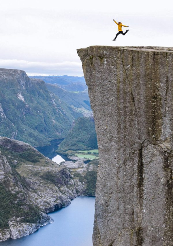 Craig Jumping on the edge of Pulpit Rock near Stavanger, Norway