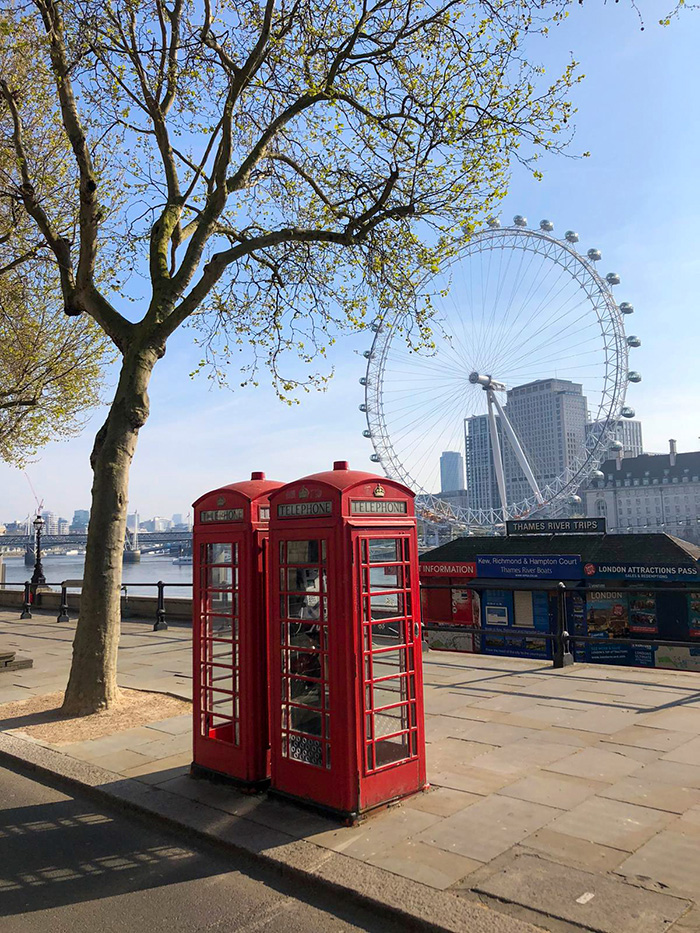 A view of two of London's iconic features: 1. The famous red telephone booths and the London Eye