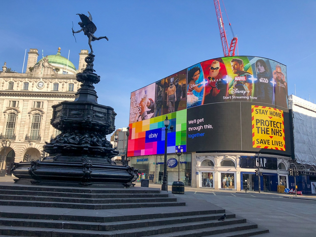Piccadilly Circus on a clear blue day without a soul in sight